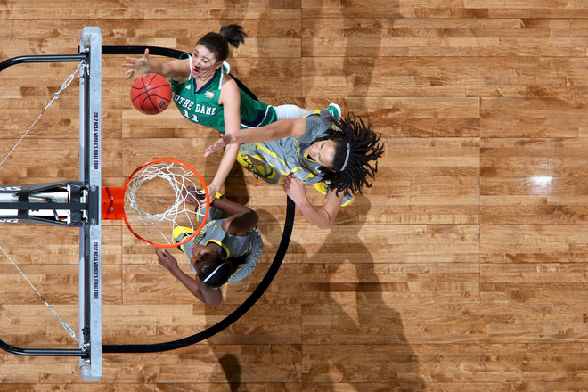 Natalie Achonwa #11 Of The Notre Dame Fighting Irish Drives For A Shot Attempt Against Brittney Griner #42 Of The