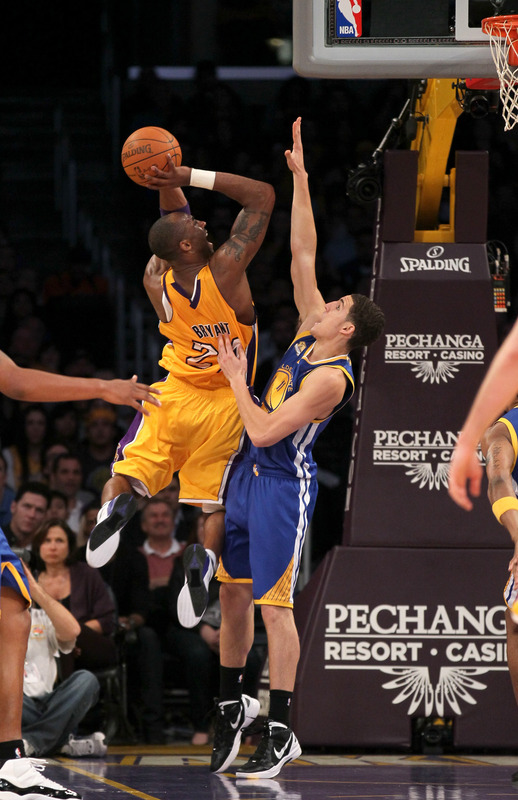 Kobe Bryant #24 Of The Los Angeles Lakers Shoots