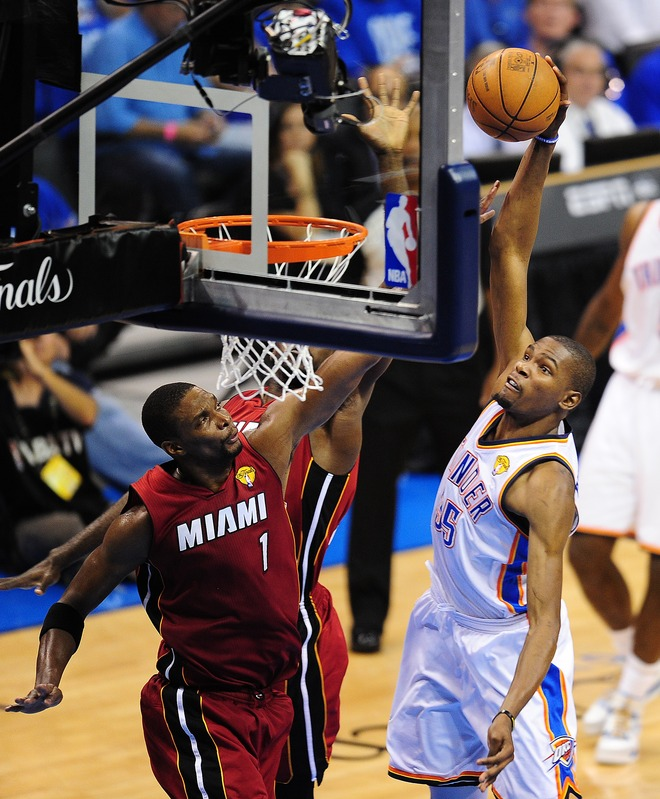 Oklahoma City Thunder's Kevin Durant (R) Drives
