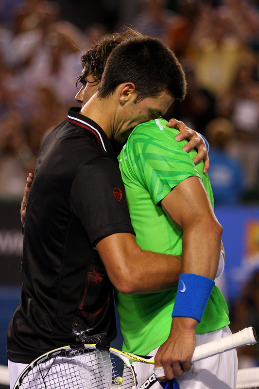 Novak Djokovic Of Serbia Hugs