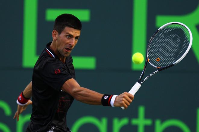 Novak Djokovic Of Serbia In Action Against David Ferrer Of Spain