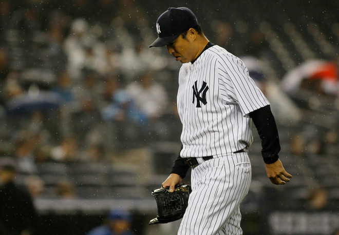 Hiroki Kuroda #18 Of The New York Yankees Walks