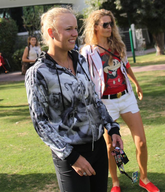 Former World Number One Caroline Wozniacki Of Denmark (L) Walks