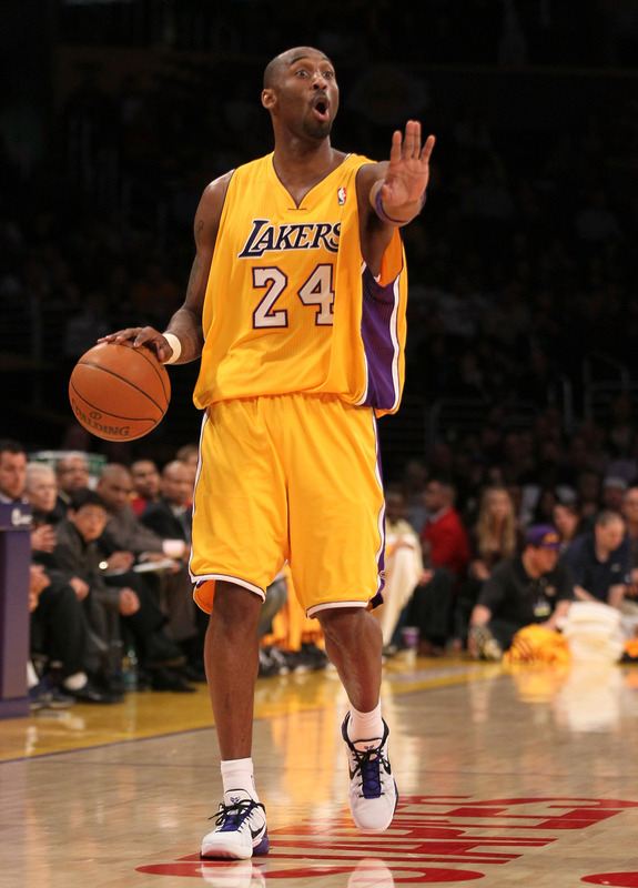 Kobe Bryant #24 Of The Los Angeles Lakers Sgnals