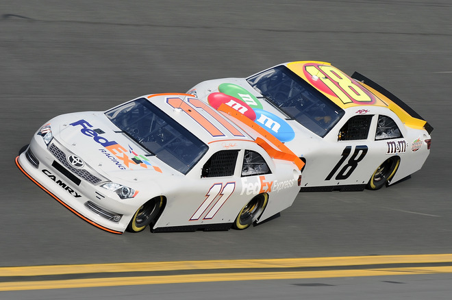 Denny Hamlin, Driver Of The #11 FedEx Express Toyota, Leads Teammate Kyle Busch, Driver Of The #18 M&M's Toyota, Out