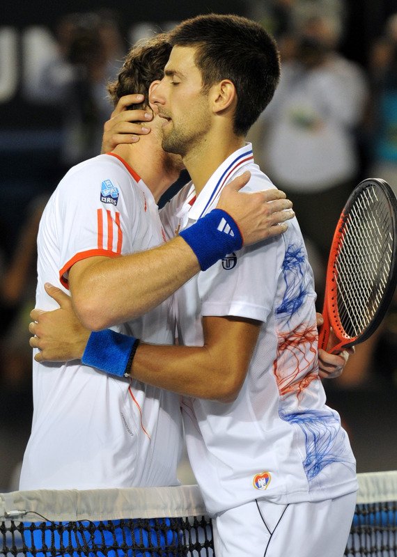 Novak Djokovic Of Serbia (R) Embraces