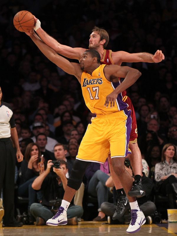 Andrew Bynum #17 Of The Los Angeles Lakers Reaches