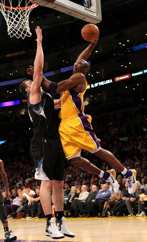Kobe Bryant #24 Of The Los Angeles Lakers Dunks