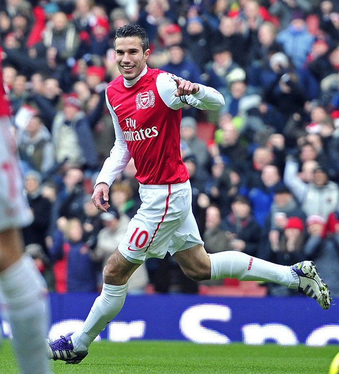 Arsenal's Dutch Striker Robin Van Persie Celebrates Scoring The Opening Goal Of The English Premier League Football
