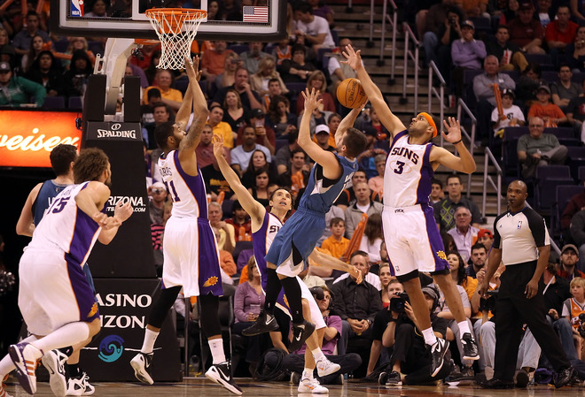 Jose Barea #11 Of The Minnesota Timberwolves Puts Up A Shot Under Pressure From Markieff Morris #11, Steve Nash #13