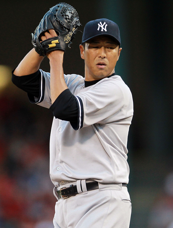 Hiroki Kuroda #18 Of The New York Yankees Throws