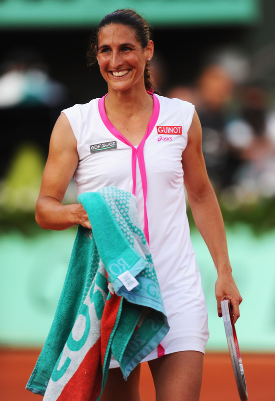 Virginie Razzano Of France Smiles As She Celebrates Victory In Her Women's Singles First Round Match Between Serena