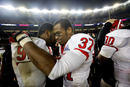 NEW YORK - DECEMBER 30: (L-R) Jamil Merrell #92 and Jamal Merrell #37 of the Rutgers Scarlet Knights celebrate a win over the Iowa State Cyclones in the New Era Pinstripe Bowl at Yankee Stadium on December 30, 2011 in the Bronx Borough of New York City. (Photo by Jeff Zelevansky/Getty Images)