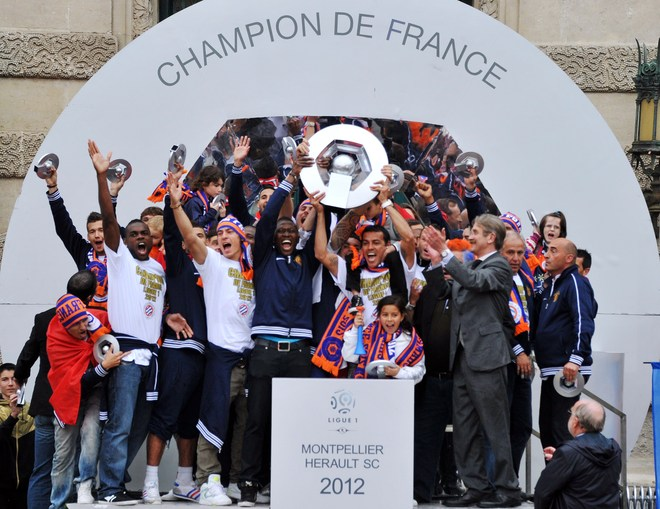 Montpellier's Football Club Players Celebrate With Supporters, At The Place De La Comedie On May 21, 2012 In