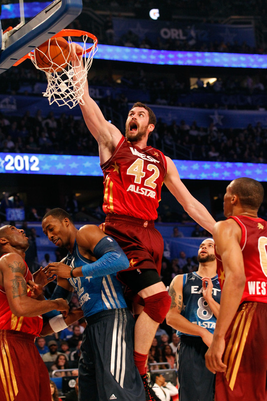 Kevin Love #42 Of The Minnesota Timberwolves And The Western Conference Dunks Against Dwight Howard #12 Of The