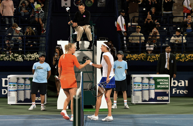 Julia Goerges Of Germany (R) Shakes