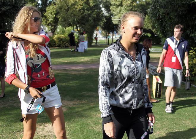 Former World Number One Caroline Wozniacki Of Denmark (C) Walks