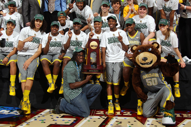 Heisman Trophy Winning Quarterback Robert Griffin III (bottom C) From The Baylor Bears Poses For A Photo With The