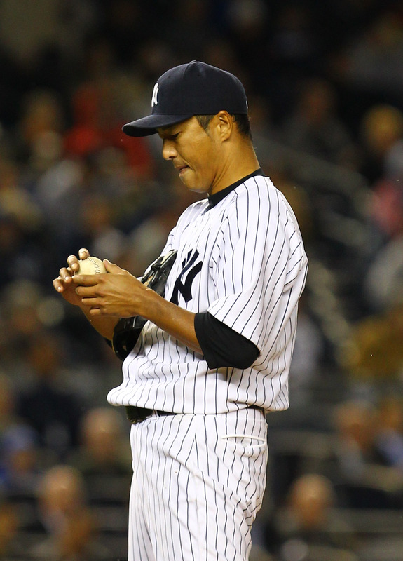 Hiroki Kuroda #18 Of The New York Yankees Reacts