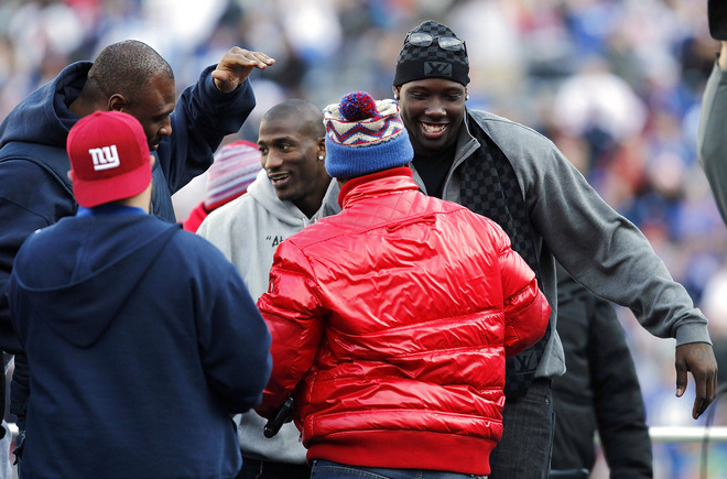 Jason Pierre-Paul #90, Antrel Rolle #26 And Brandon Jacobs #27 Of The New York Giants Dance With Members