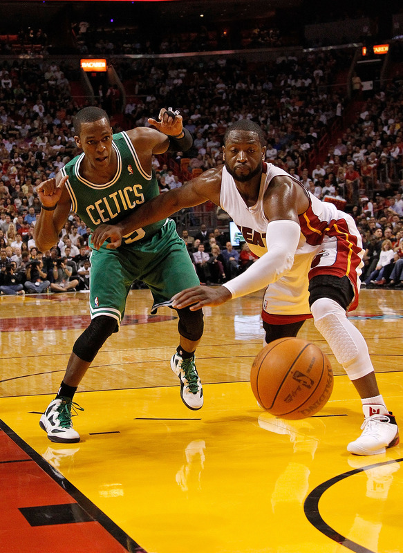 Dwyane Wade #3 Of The Miami Heat And Rajon Rondo #9 Of The Boston Celtics Fight For A Loose Ball