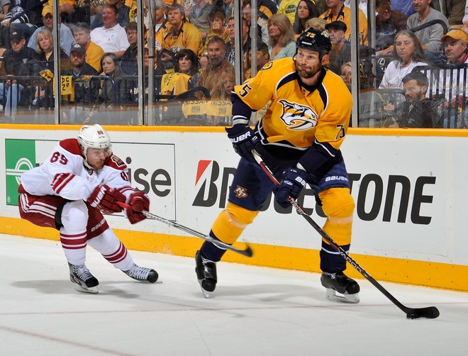 Mikkel Boedker #89 Of The Phoenix Coyotes Hooks Hal Gill #75 Of The Nashville Predators In Game Three Of The Western