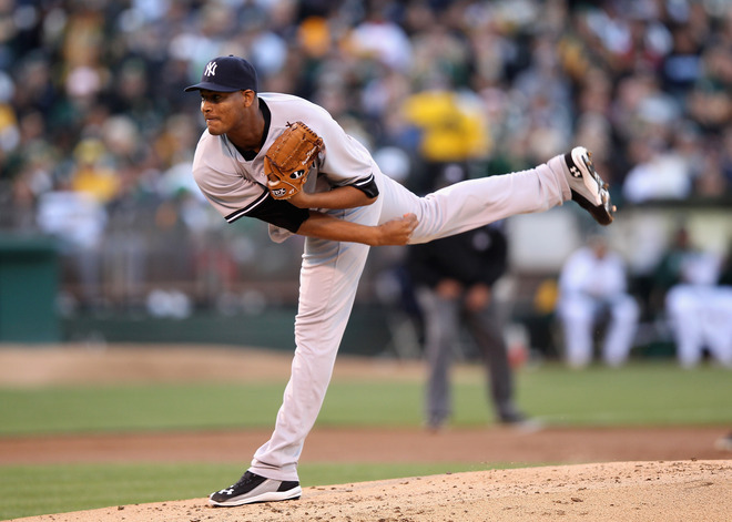 Ivan Nova #47 Of The New York Yankees Pitches