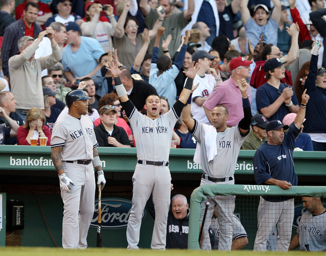 Andruw Jones #22,Nick Swisher #33 And Derek Jeter #2 Of The New York Yankees Celebrate