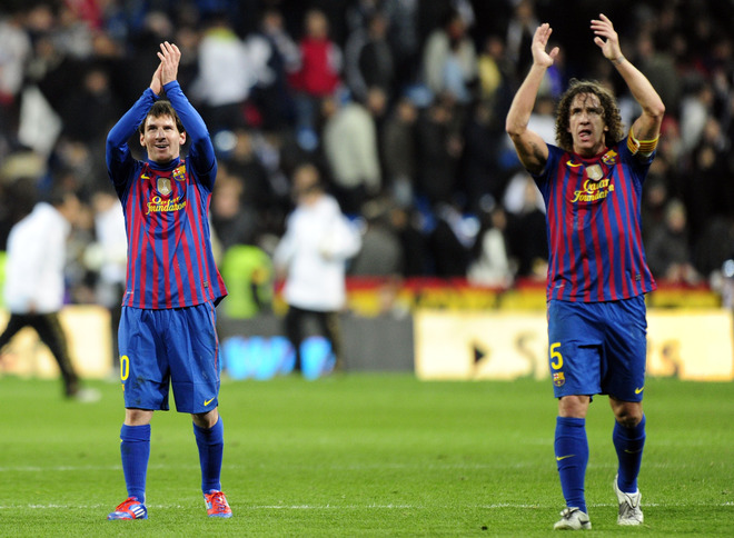 Barcelona's Argentinian Forward Lionel Messi (L) And Barcelona's Captain Carles Puyol (R) Applaud