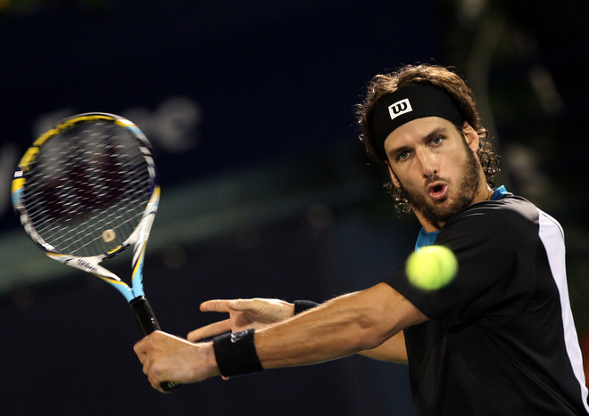 Feliciano Lopez Of Spain Returnsl To Swiss Champion Roger Federer