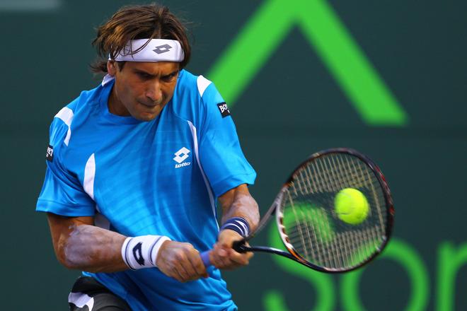 David Ferrer Of Spain In Action Against Novak Djokovic Of Serbia