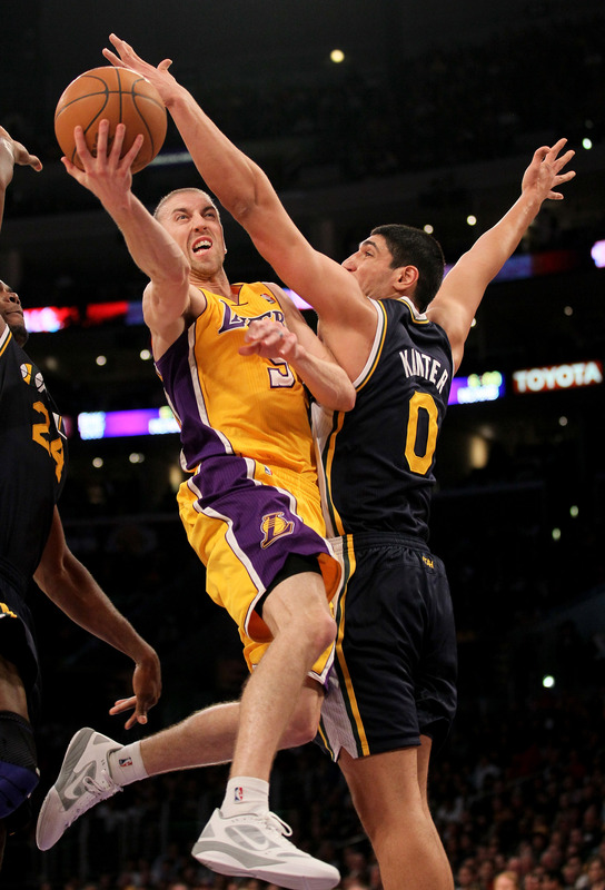 Enes Kanter defends against Steve Blake
