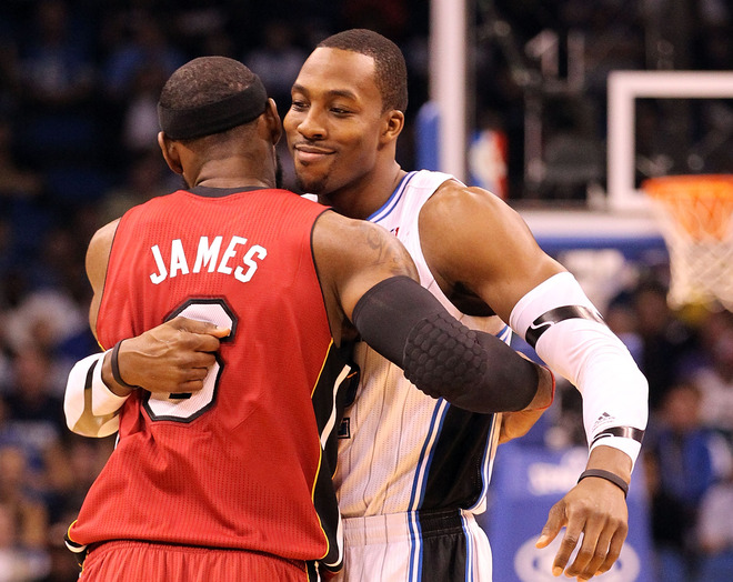 LeBron James #6 Of The Miami Heat Hugs