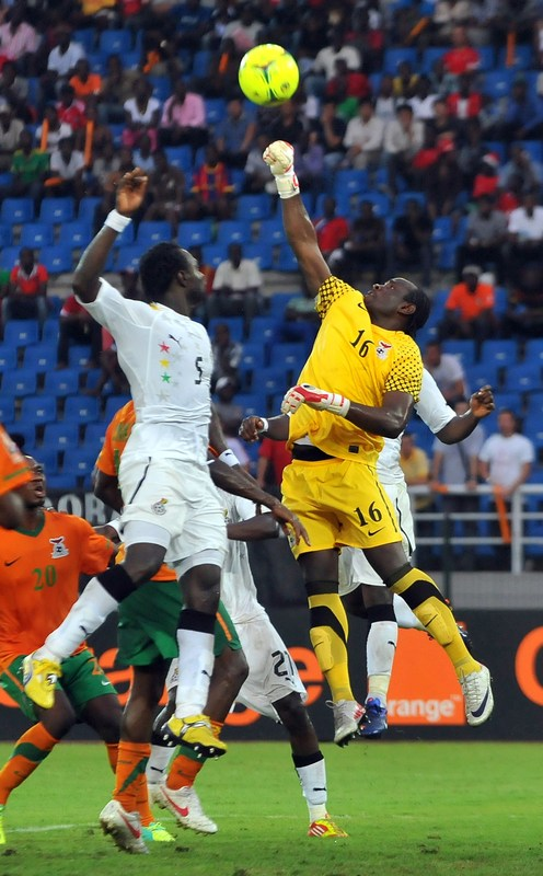 Zambian Goalkeeper Kennedy Mweene (R) Clears