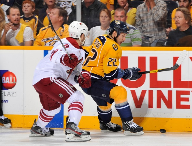Gilbert Brule #8 Of The Phoenix Coyotes Checks Jordin Tootoo #22 Of The Nashville Predators In Game Three Of The