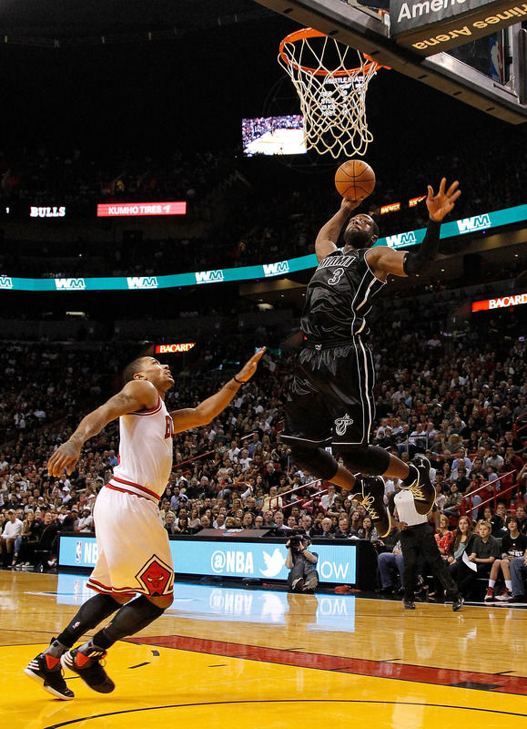 Dwyane Wade #3 Of The Miami Heat Dunks