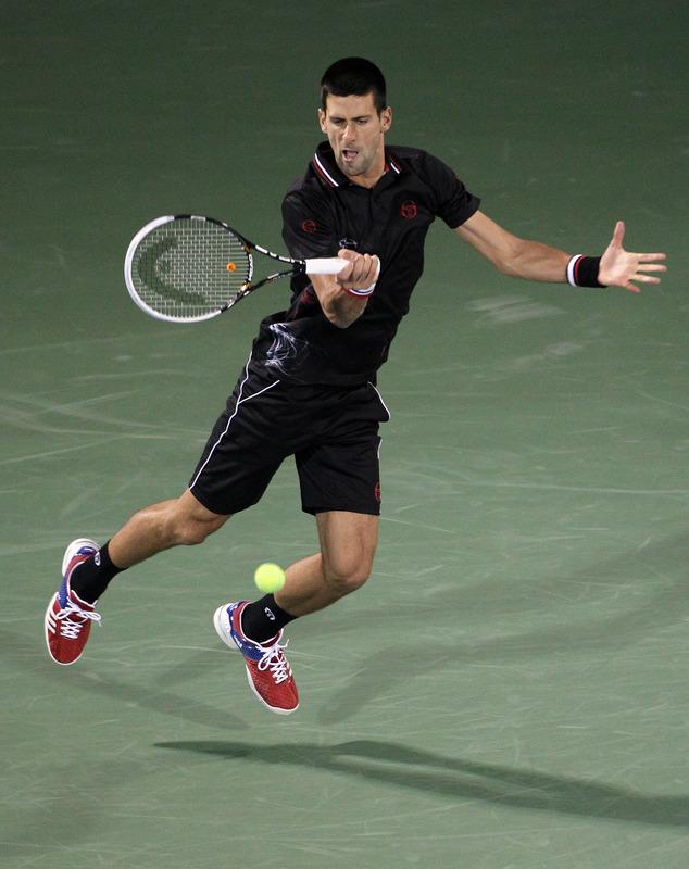 World Number One Novak Djokovic Of Serbia Returns