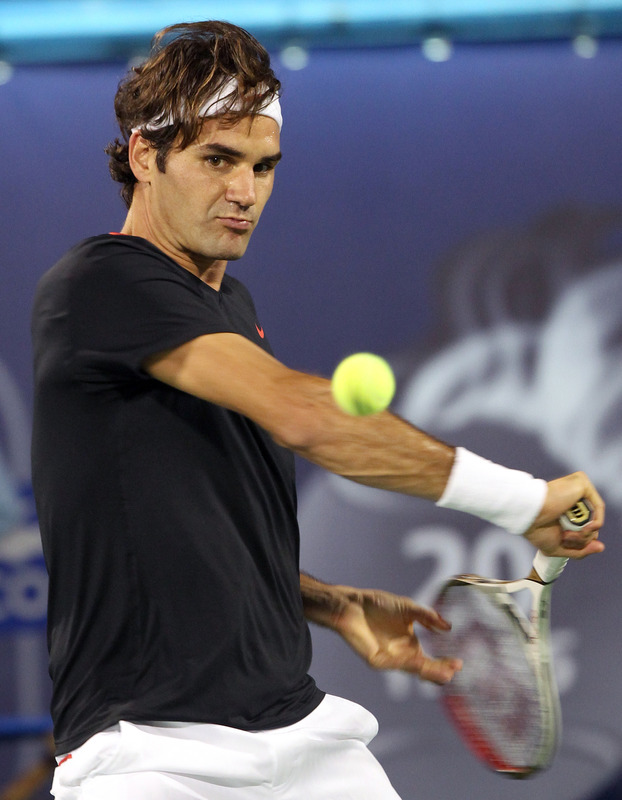 Roger Federer Of Switzerland Returns