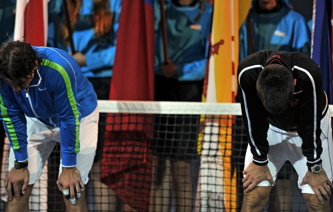 Novak Djokovic Of Serbia (R) And Rafael Nadal Of Spain (L) Look Exhausted