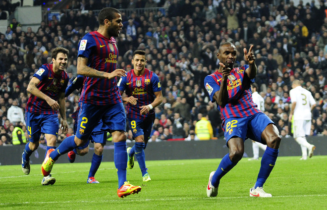 Barcelona's French Defender Eric Abidal (R) Celebrates