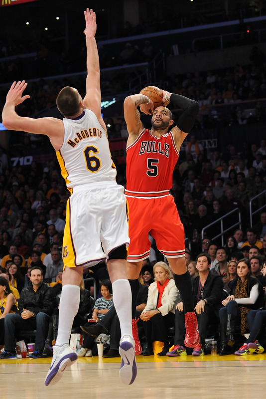 Carlos Boozer #5 Of The Chicago Bulls Puts