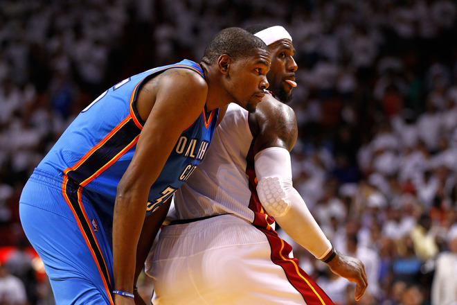(L-R) Kevin Durant #35 And LeBron James #6 Of The Miami Heat Look On In The Seocnd Half Of Game Three Of The 2012 NBA