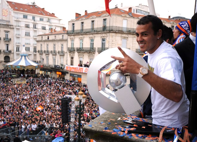 Montpellier's Football Club Brazilian Defender Victorino Hilton Holds The Trophy As He Celebrates With His Teammates
