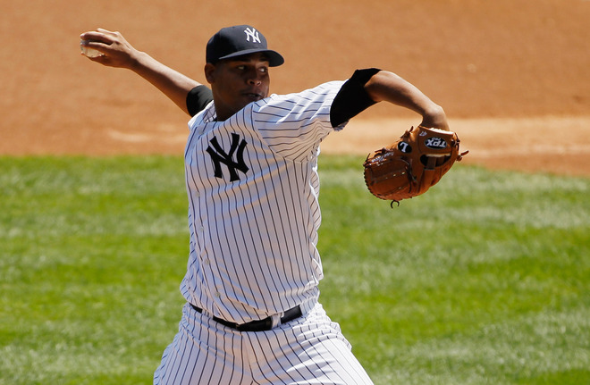 Ivan Nova #47 Of The New York Yankees Delivers