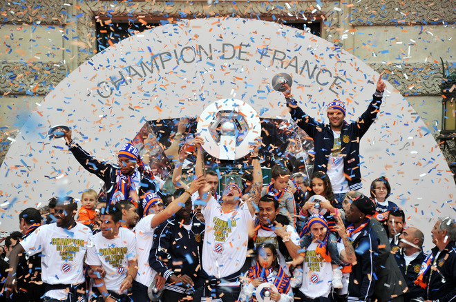 Montpellier's Football Club Players Celebrate With Their Trophy, At The Place De La Comedie On May 21, 2012 In