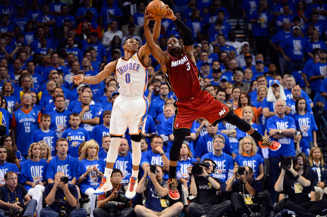 Russell Westbrook #0 Of The Oklahoma City Thunder And Dwyane Wade #3 Of The Miami Heat Battle For A Ball In The