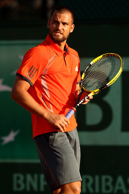 Mikhail Youzhny Of Russia Celebrates A Point In His Men's Singles First Round Match Between James Blake Of USA And