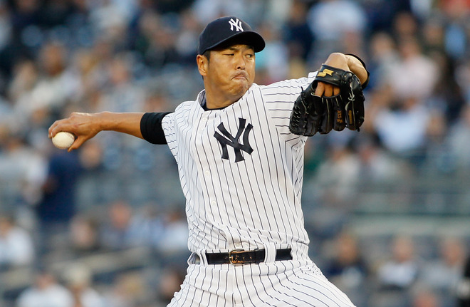 Hiroki Kuroda #18 Of The New York Yankees Delivers
