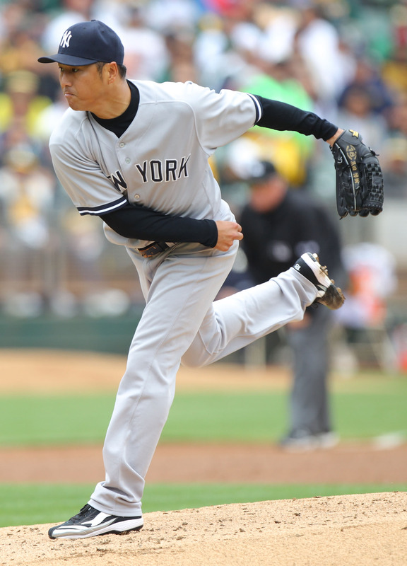 Hiroki Kuroda #18 Of The New York Yankees Pitches