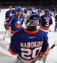 UNIONDALE, NY - DECEMBER 31: New York Islanders line up to congratulate Evgeni Nabokov #20 following a 4-1 victory over the Edmonton Oilers at the Nassau Veterans Memorial Coliseum on December 31, 2011 in Uniondale, New York.  (Photo by Bruce Bennett/Getty Images)
